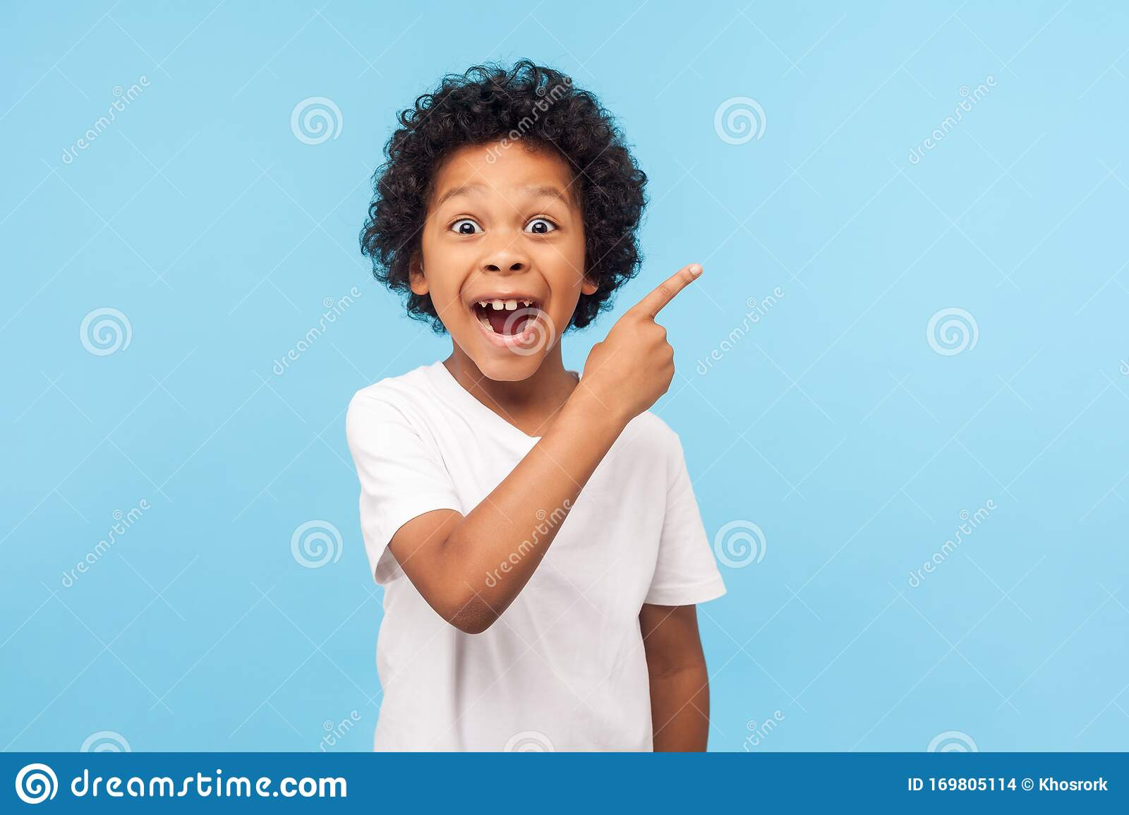 Wow Look Advertise Here Portrait Of Amazed Cute Little Boy With Curly Hair Pointing To Empty Place Stock Photo Image Of Little Empty 169805114