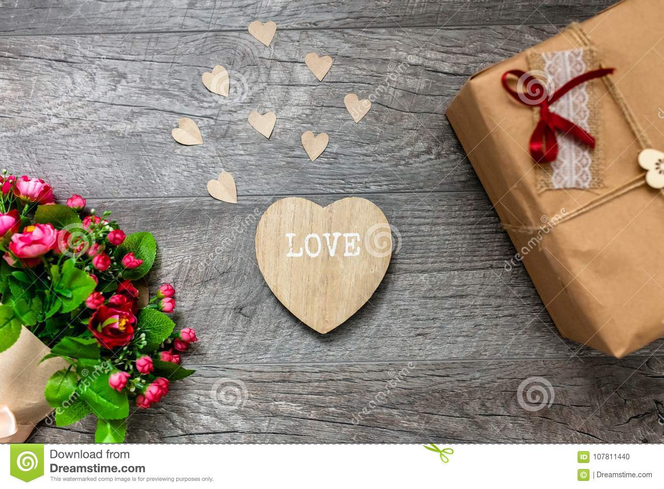 Wrapped Gift On A Wooden Grey Background Valentines Day Romantic