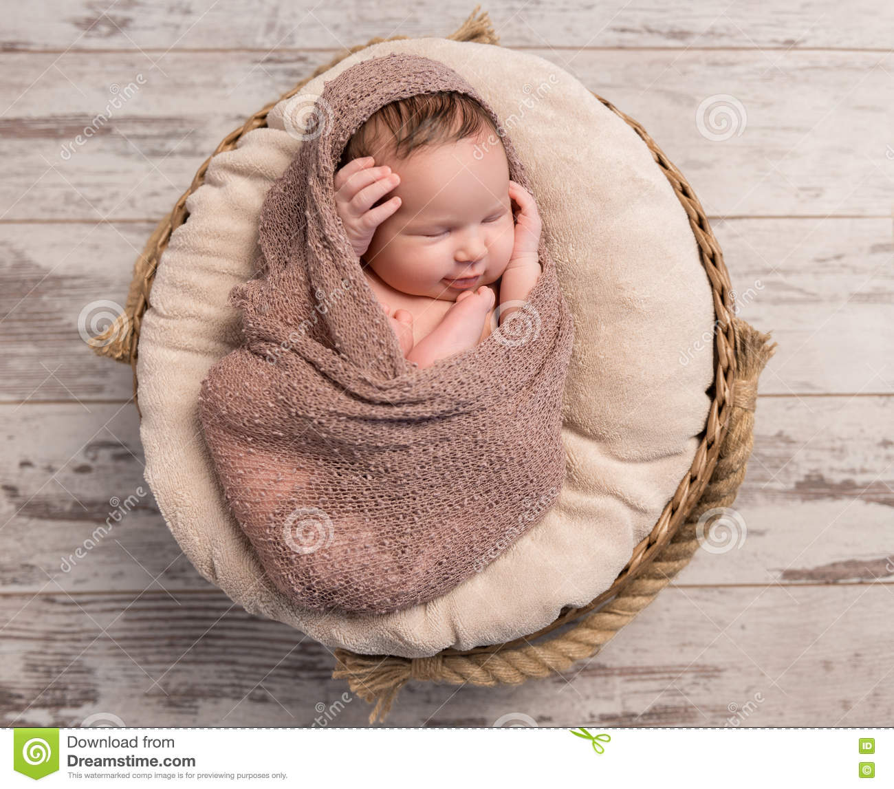 435c37ce1 Wrapped Sleepy Baby With Folded Legs And Hands On Head Stock Photo ...