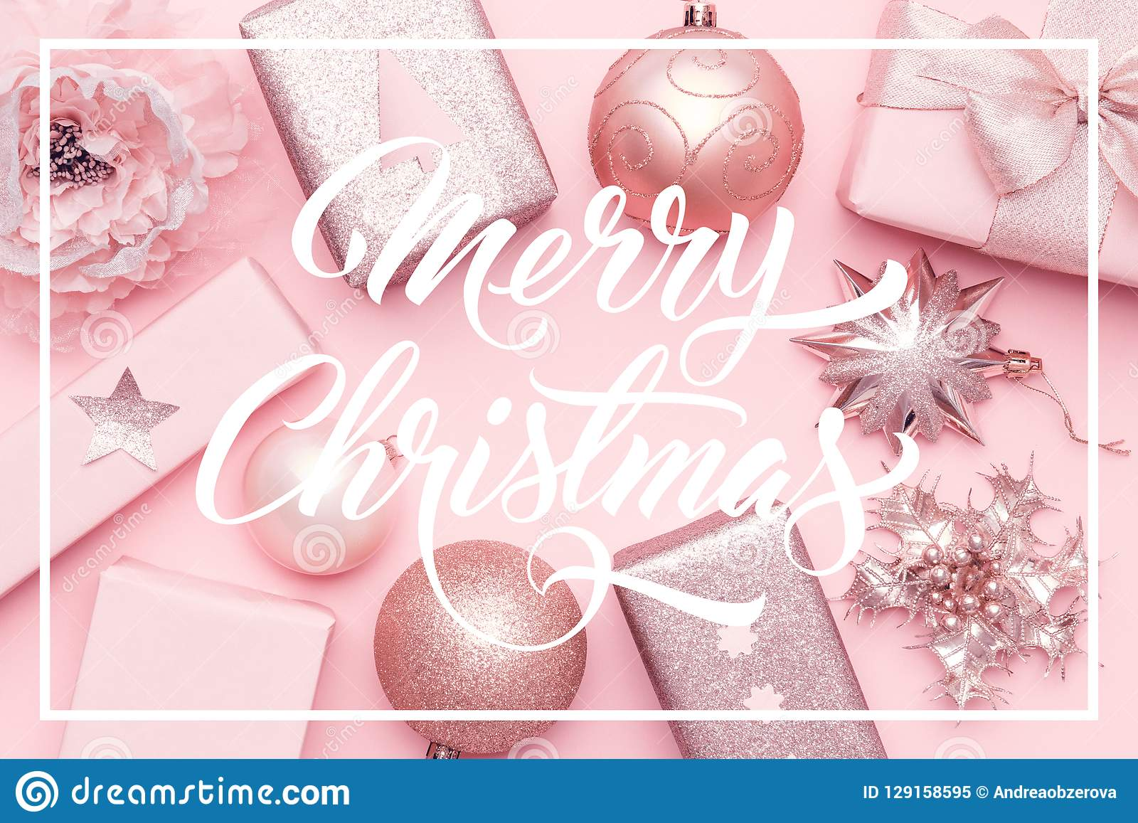 Wrapped xmas boxes, christmas ornaments and baubles. Pink christmas gifts isolated on pastel pink background.