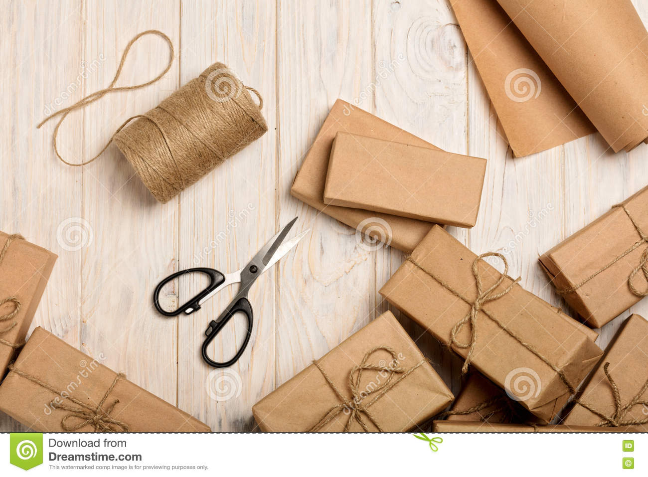 Wrapping Christmas gifts in Kraft paper and rope.