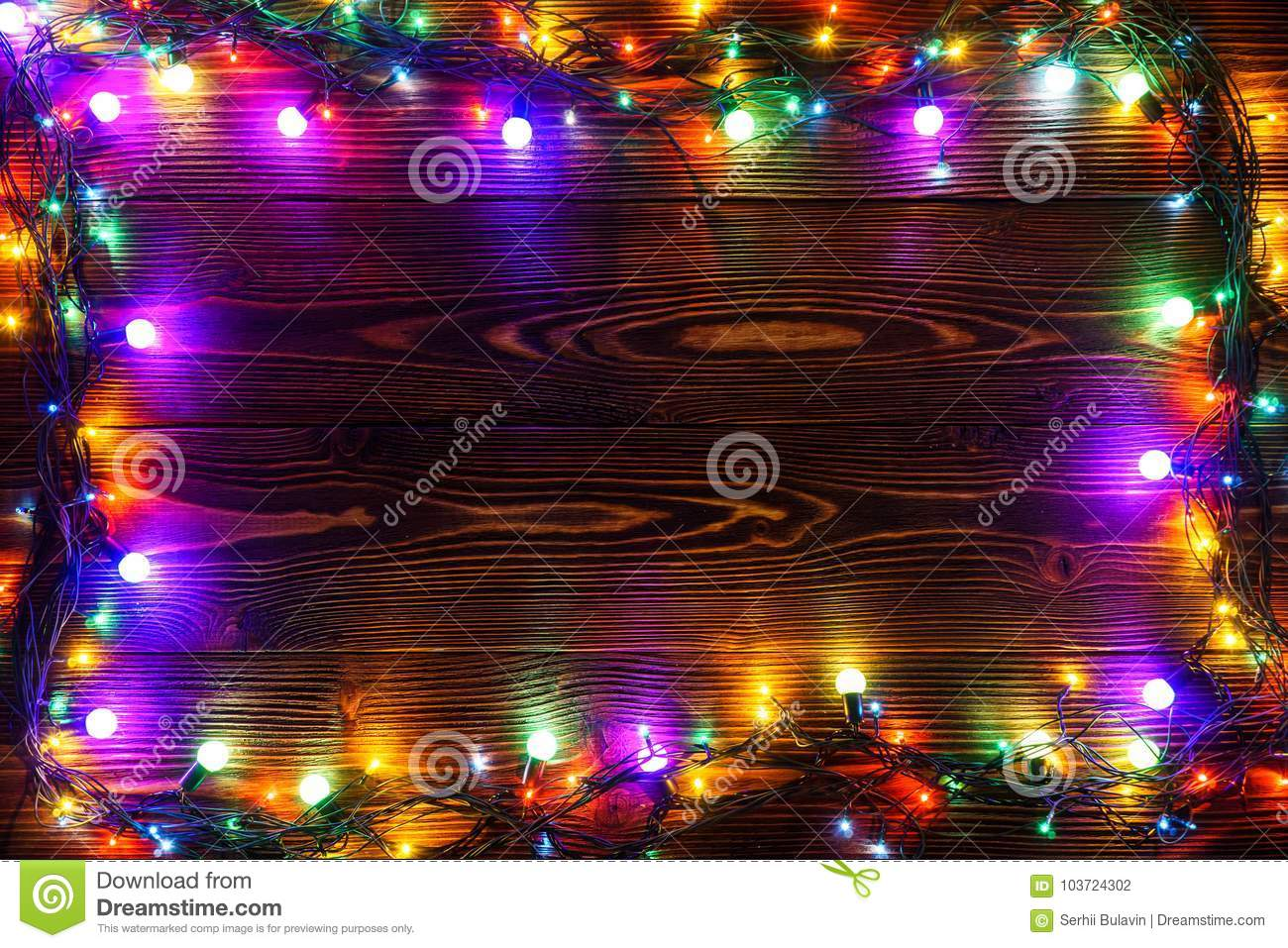 christmas background with lights and free text space christmas lights border glowing colorful christmas lights on wooden background new year