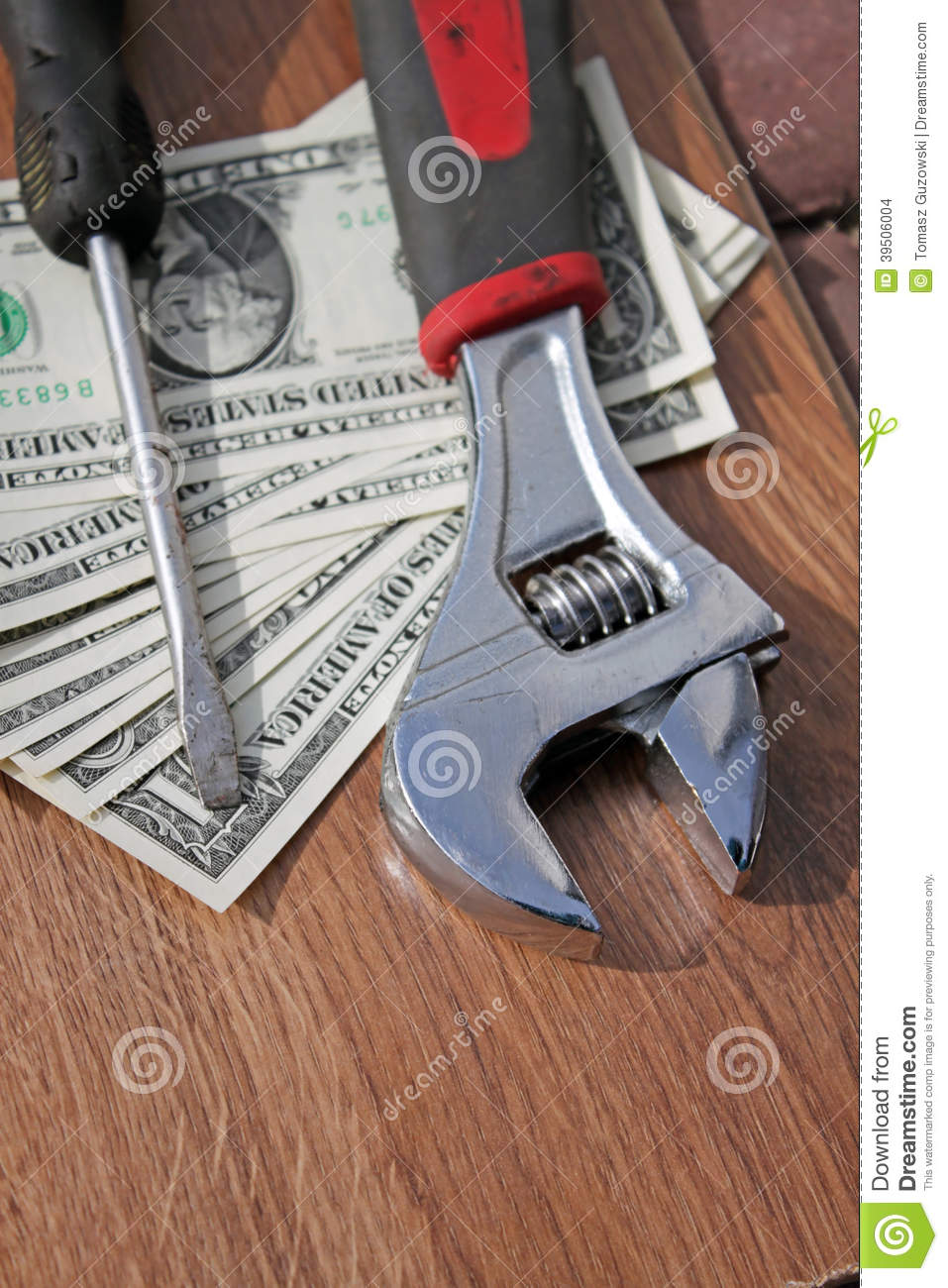 Wrench, screwdriver and dollars
