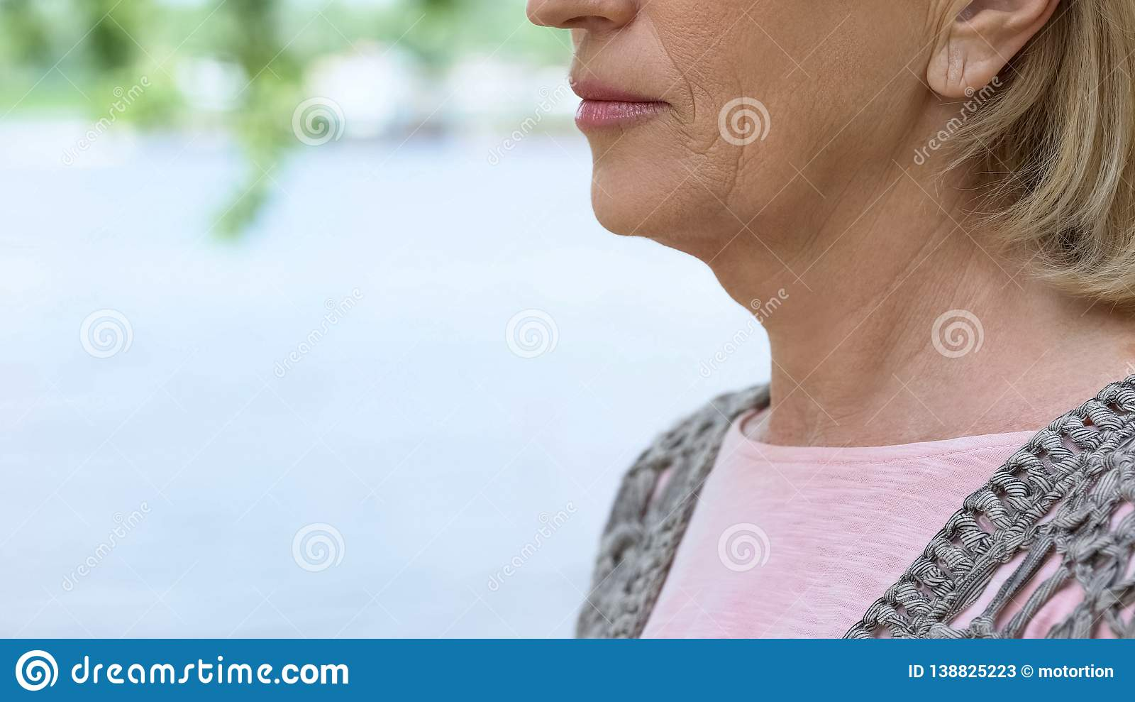 Wrinkled old woman close up, thyroid gland illness, medical examination, health