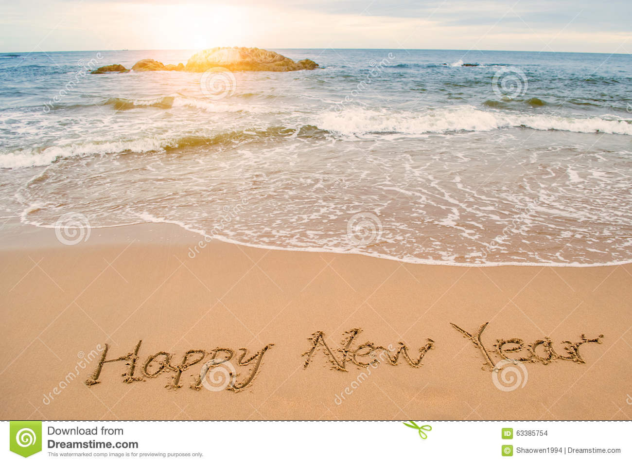 write happy new year on beach