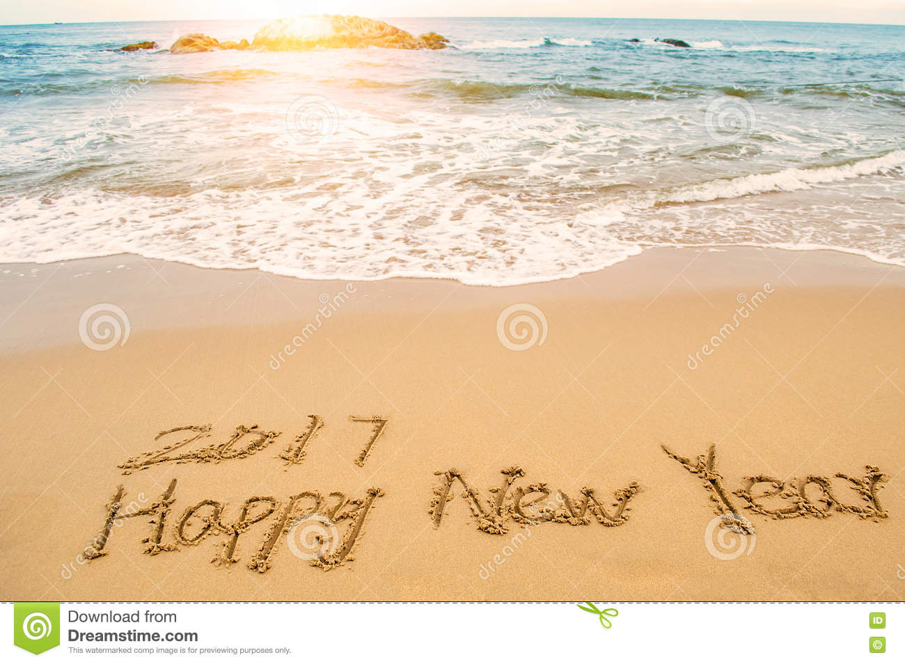 write happy new year 2017 on beach