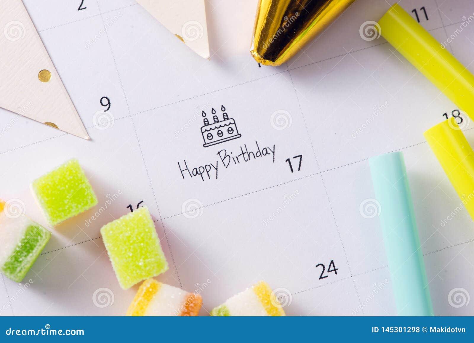 Writing cake on calendar happy birthday