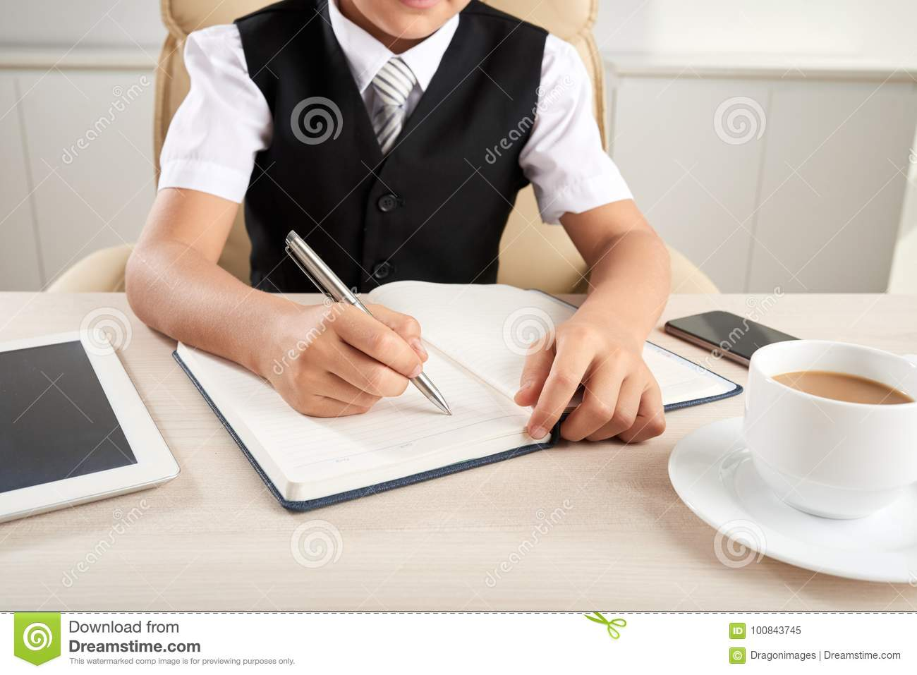 writing essay stock image image of office businessman   cropped image of pupil writing essay into textbook