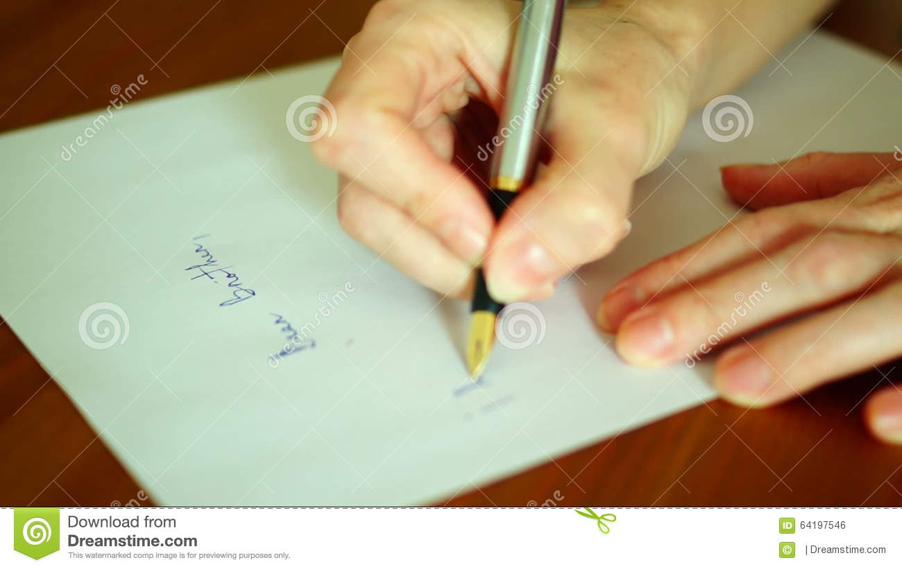 Writing letterose up of an old fashioned fountain pen writing on writing letterose up of an old fashioned fountain pen writing on a piece of paper stock footage video of calligraphy office 64197546 altavistaventures Images