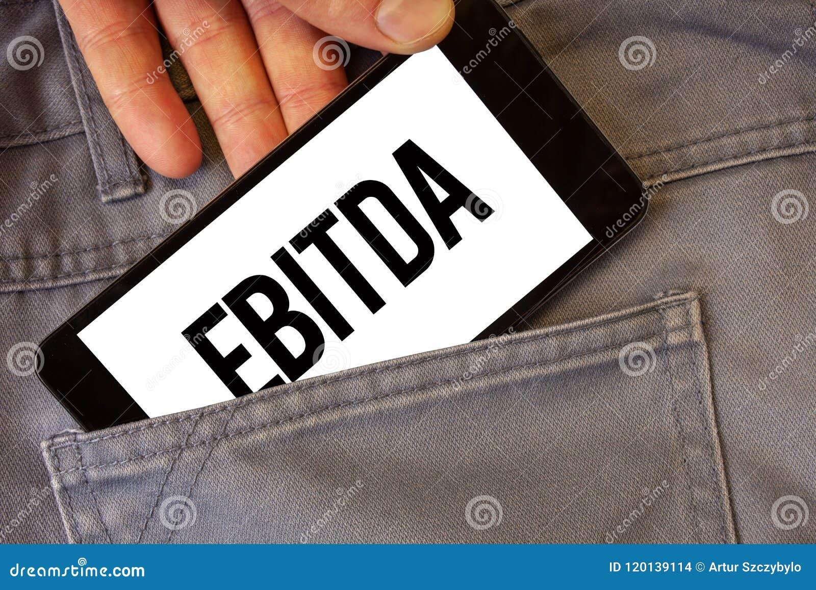 Writing note showing ebitda business photo showcasing earnings business photo showcasing earnings before interest taxes depreciation amortization abbreviation man colourmoves
