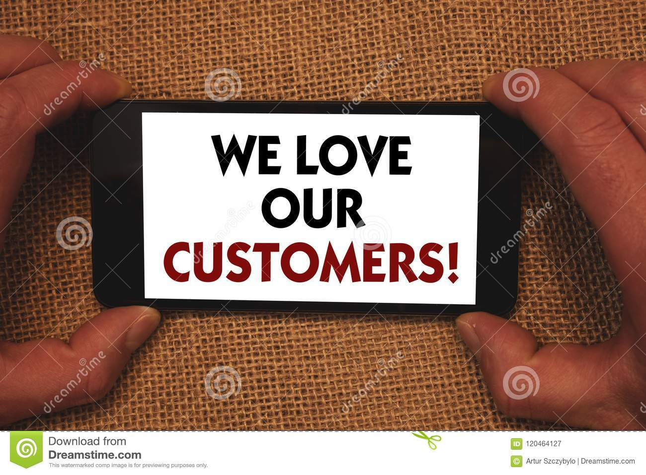 Writing note showing We Love Our Customers Call. Business photo showcasing Client deserves good service satisfaction respect Man