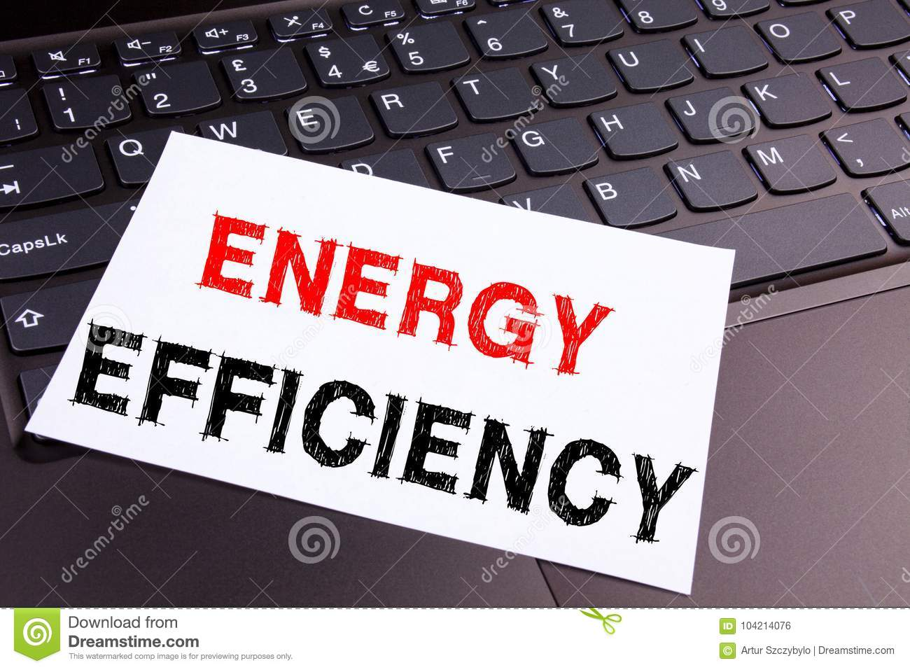 Writing showing Energy Efficiency made in the office with surroundings laptop marker pen. Business concept for Building Technology
