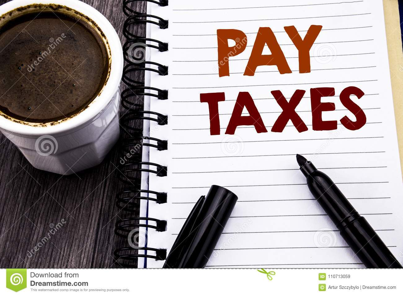 Writing text showing Pay Taxes. Business concept for Taxation Overtax Return written on notebook book note paper on the wooden woo