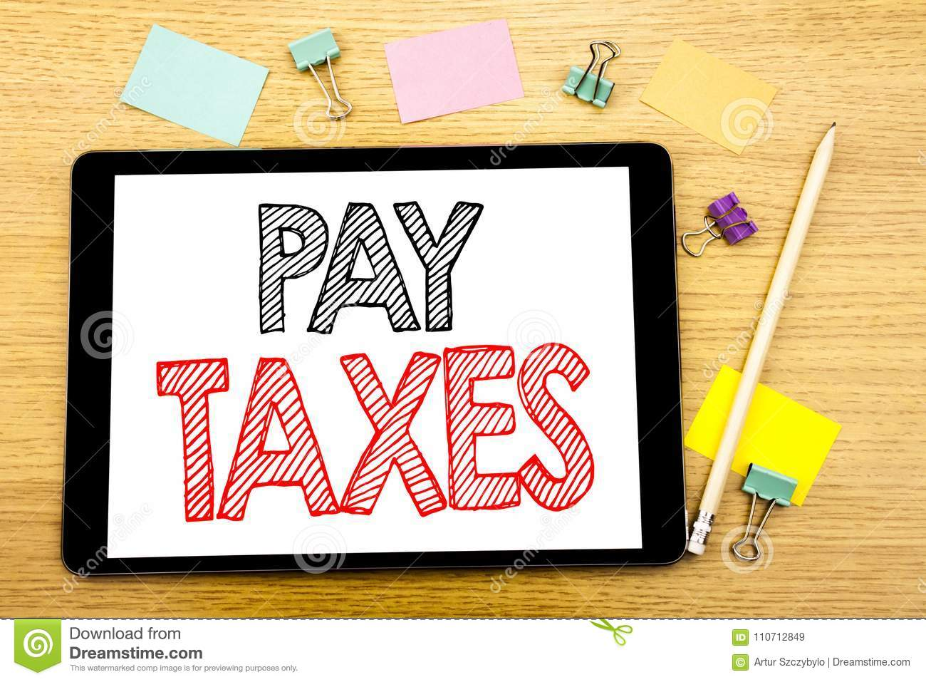 Writing text showing Pay Taxes. Business concept for Taxation Overtax Return Written on tablet laptop, wooden background with stic