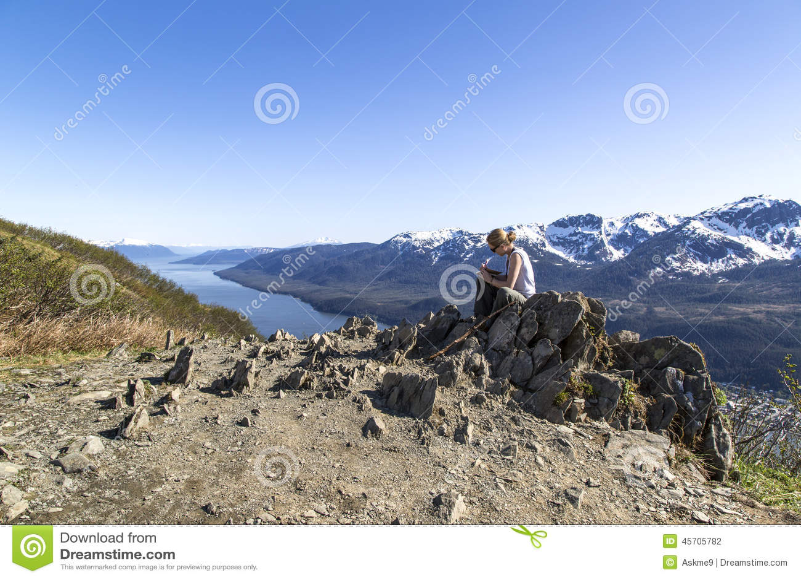 Writting diary on mountain top