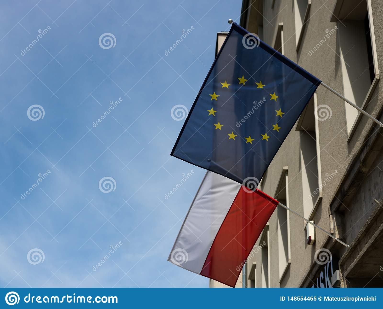 Wrocław, Poland - May 24 2019: European Union and Polish flags weaving on the building days before election to the European