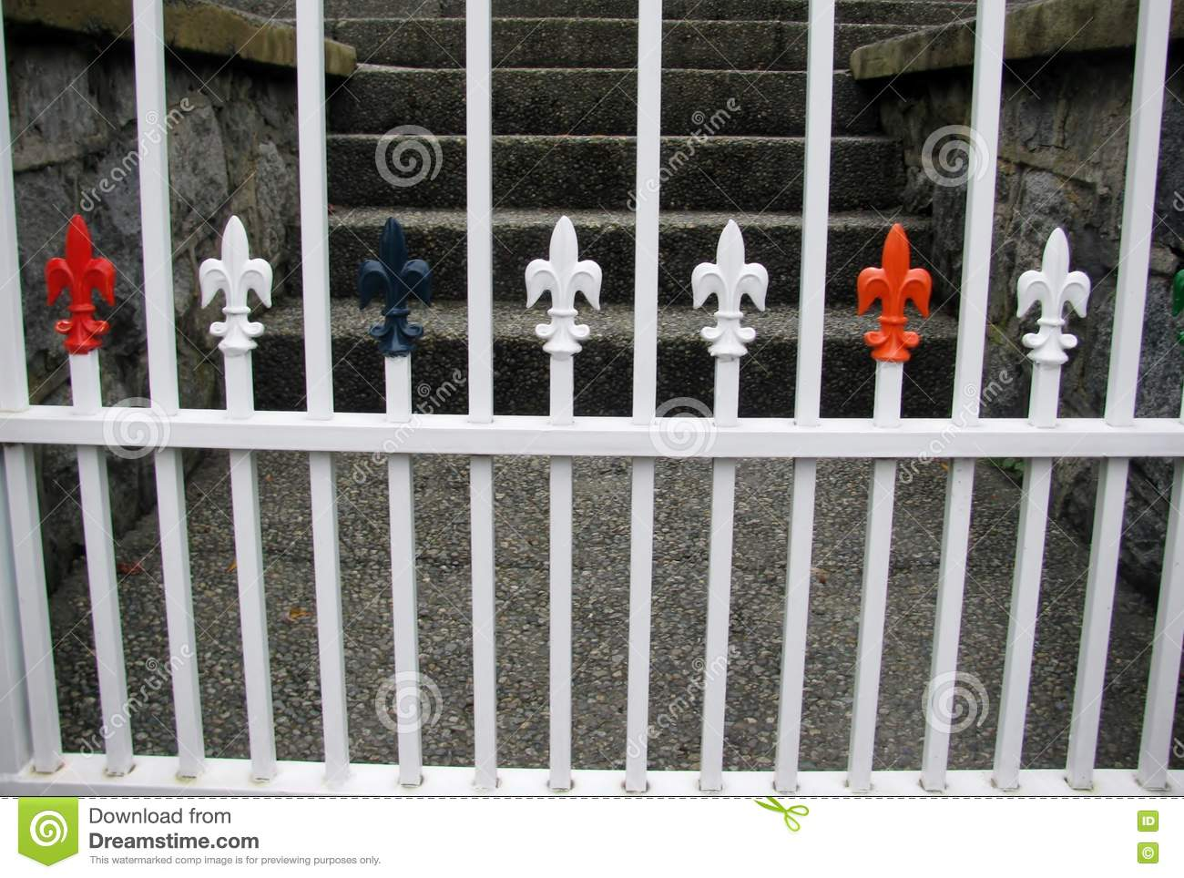 Wrought Iron Fence With Decorative Fleur De Lis Capping