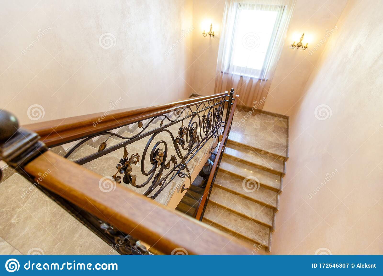 Image of: Wrought Iron Staircase In The Cottage Marble Steps Black Wrought Iron Stairs With Floral Ornaments Mahogany Wooden Railing Stock Image Image Of Decorative Construction 172546307