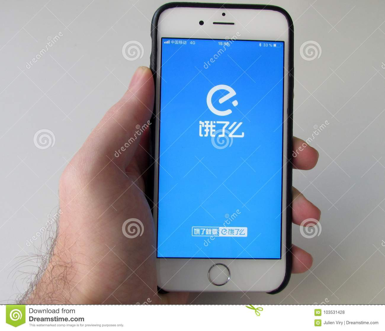 Man Holding Smartphone With Ele me Chinese Food Delivery