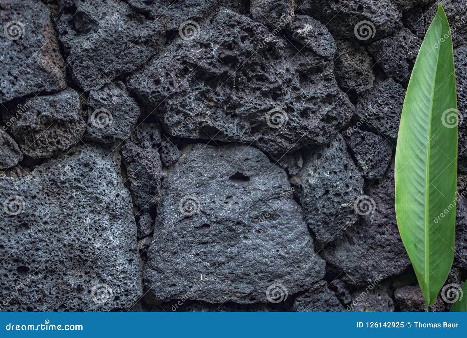 Wulkan tekstury tła kamienne cegły w ścianie