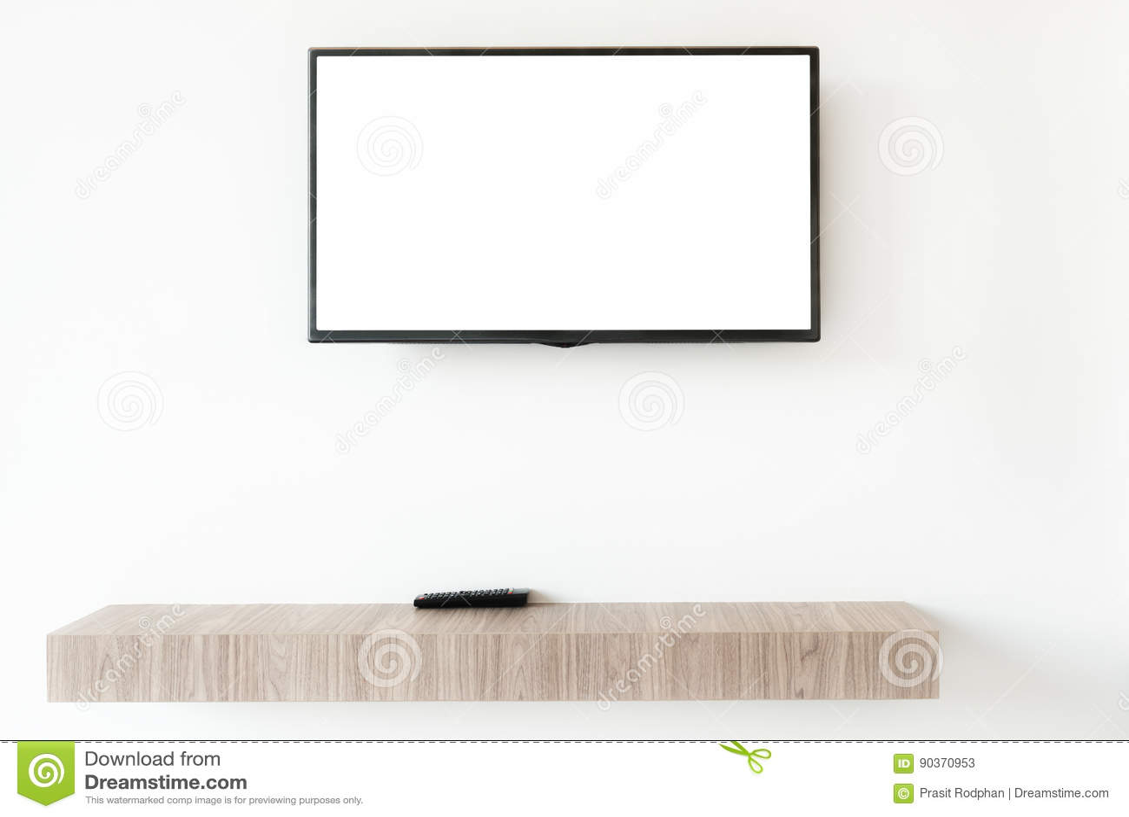 Wwden den plana tvskärmen för åtlöje upp med den avlägsna panelen på hyllan i livin