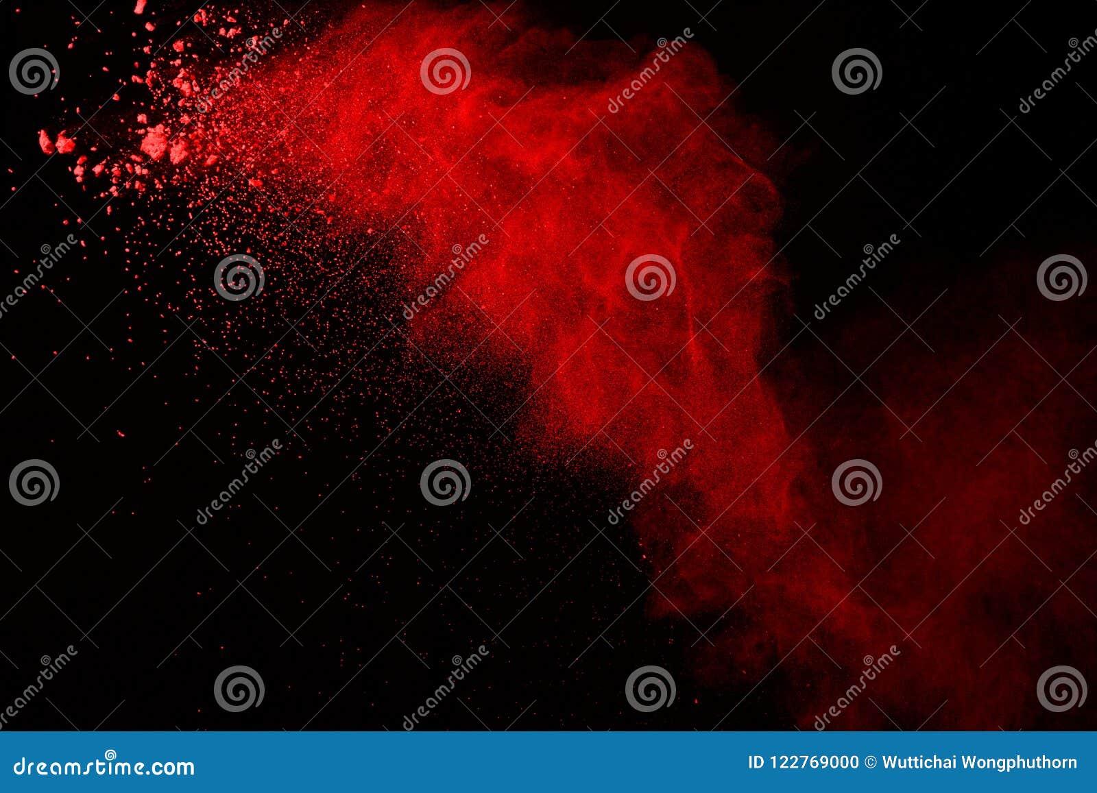 Wybuch czerwień proszek na czarnym tle Abstrakt splatted barwiony pył