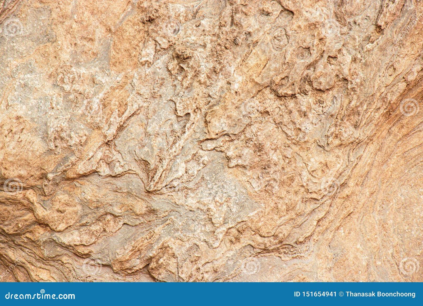 Wzory na naturalnym brązu kamieniu