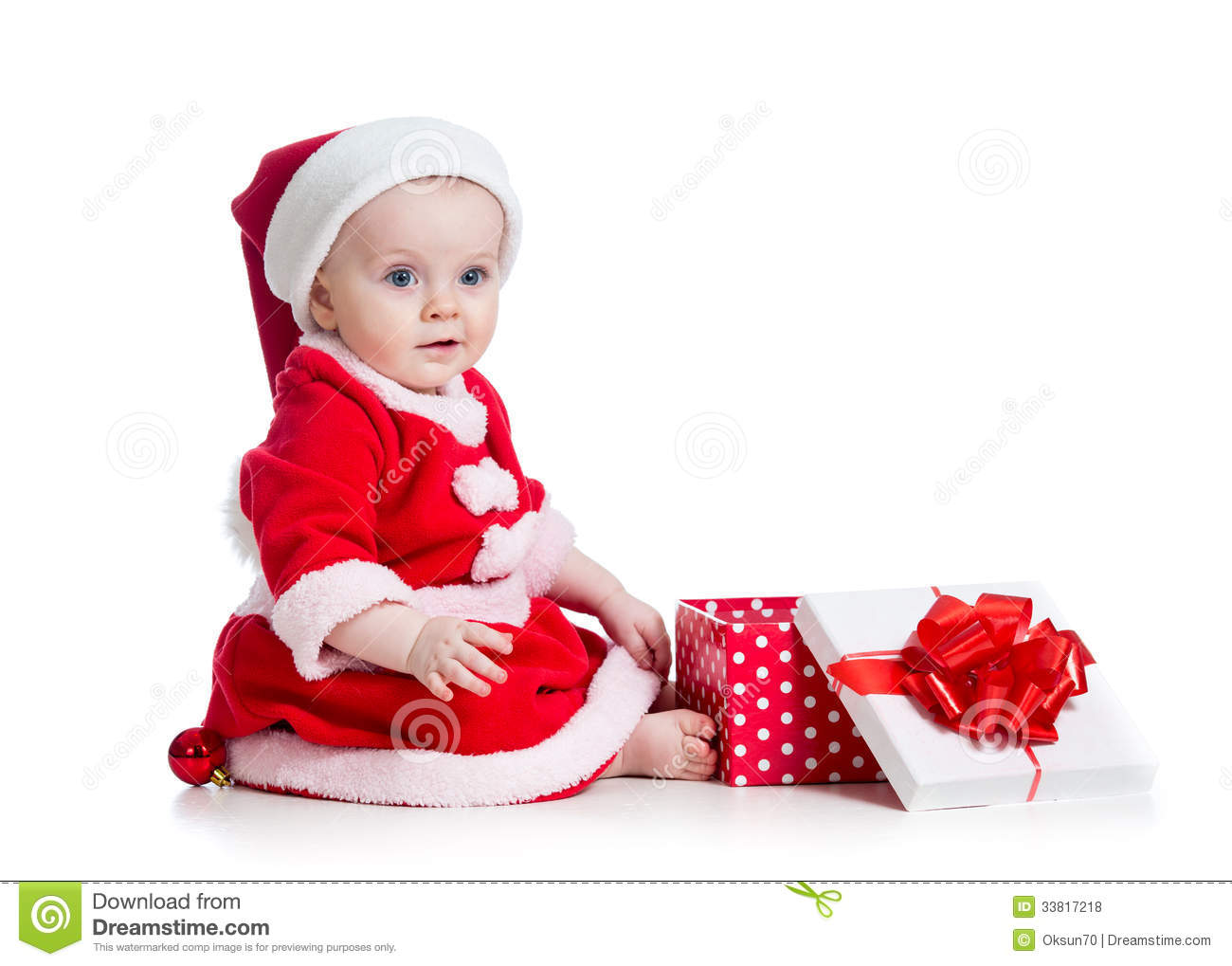 x mas baby girl opening gift box royalty free stock photos