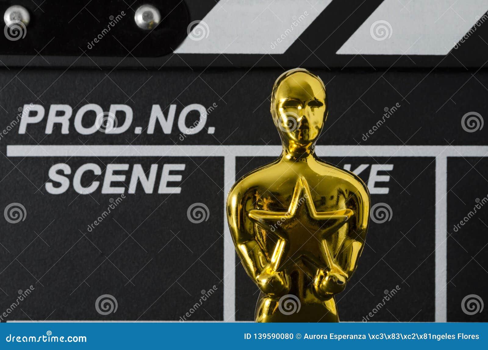 Plastic Oscar award and clapboard