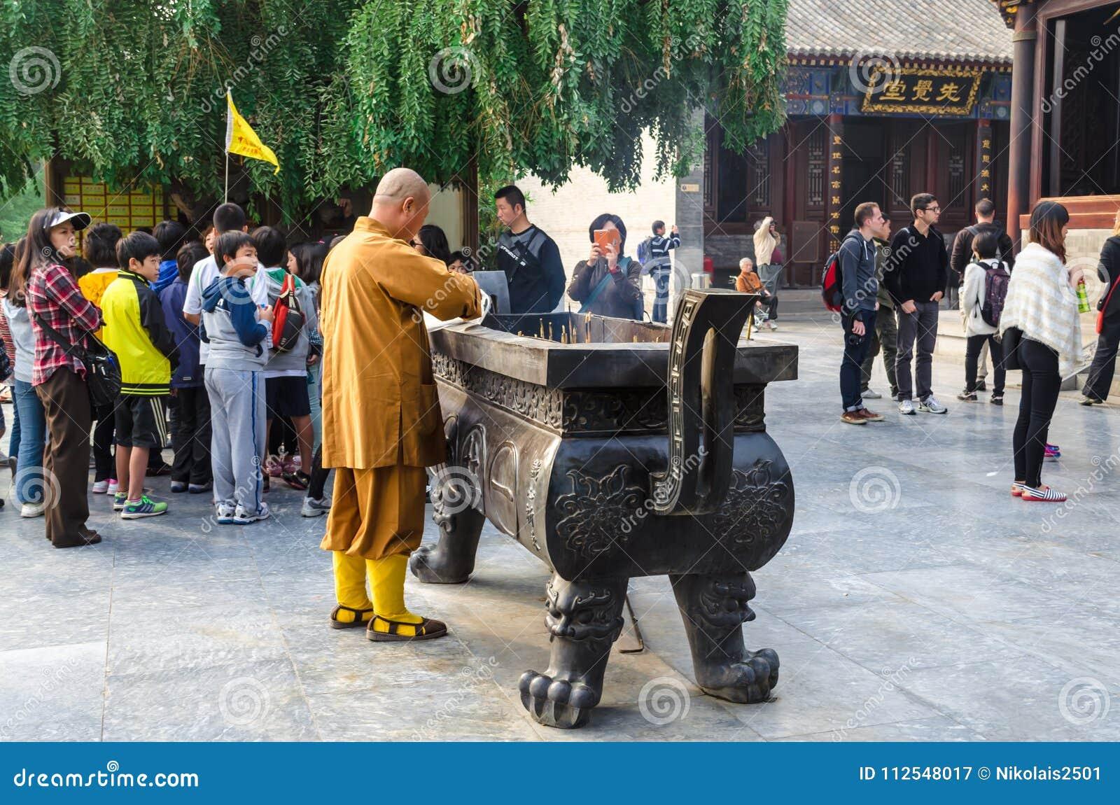 Monk at Giant Wild Goose Pagoda, Xi`an, Shaanxi Province, China.