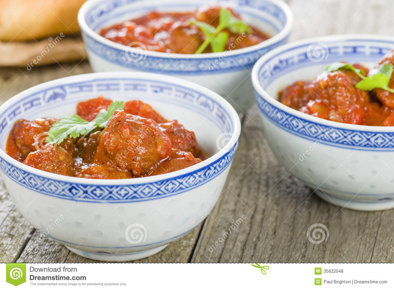 Xiu Mai - Vietnamese spicy pork meatballs in fragrant tomato sauce.