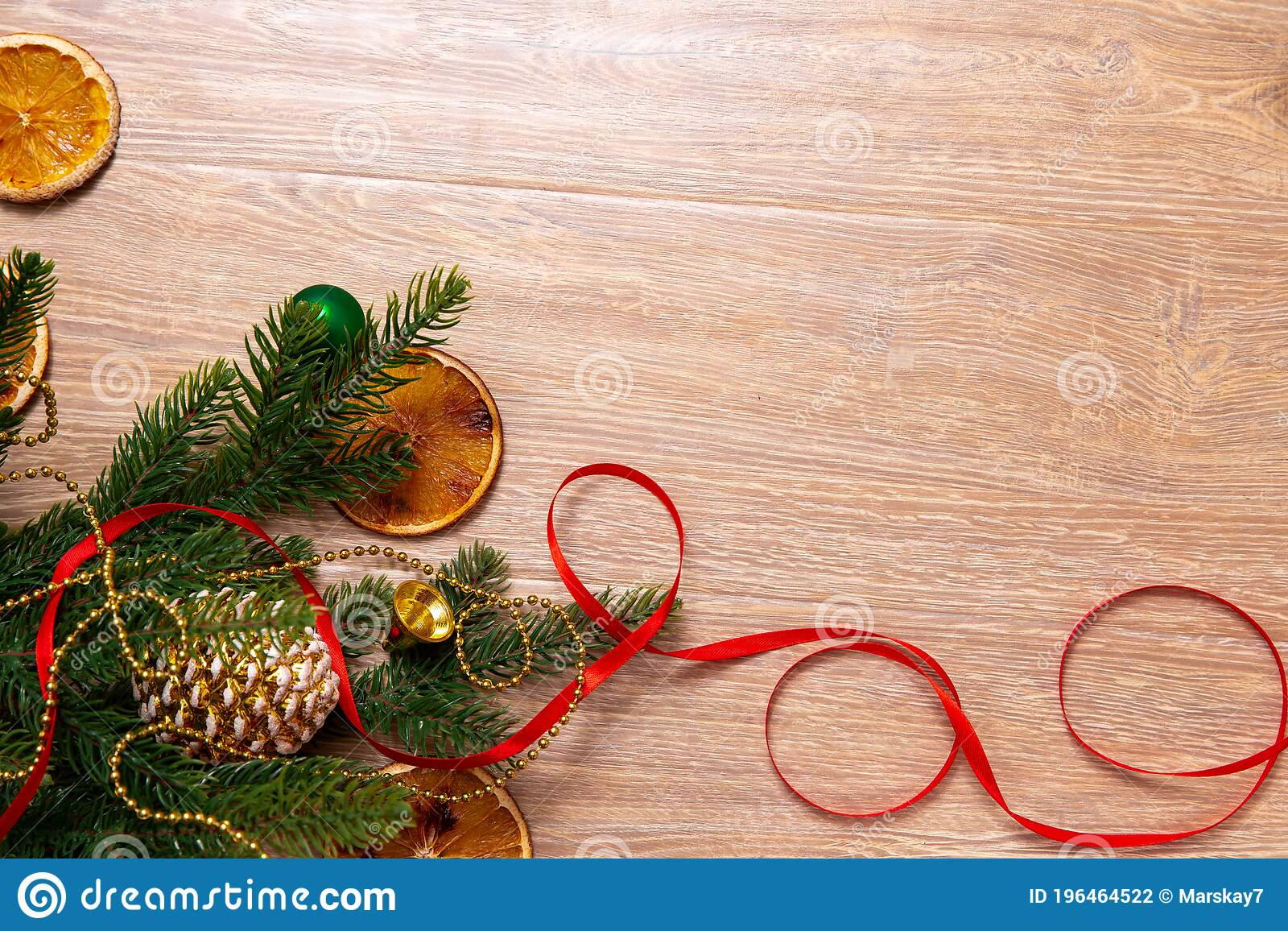 Xmas Banner With Cone Oranges Tape Beads And Christmas Tree On Wooden Background Copyspace New Year Top View Stock Photo Image Of Card Glittering 196464522