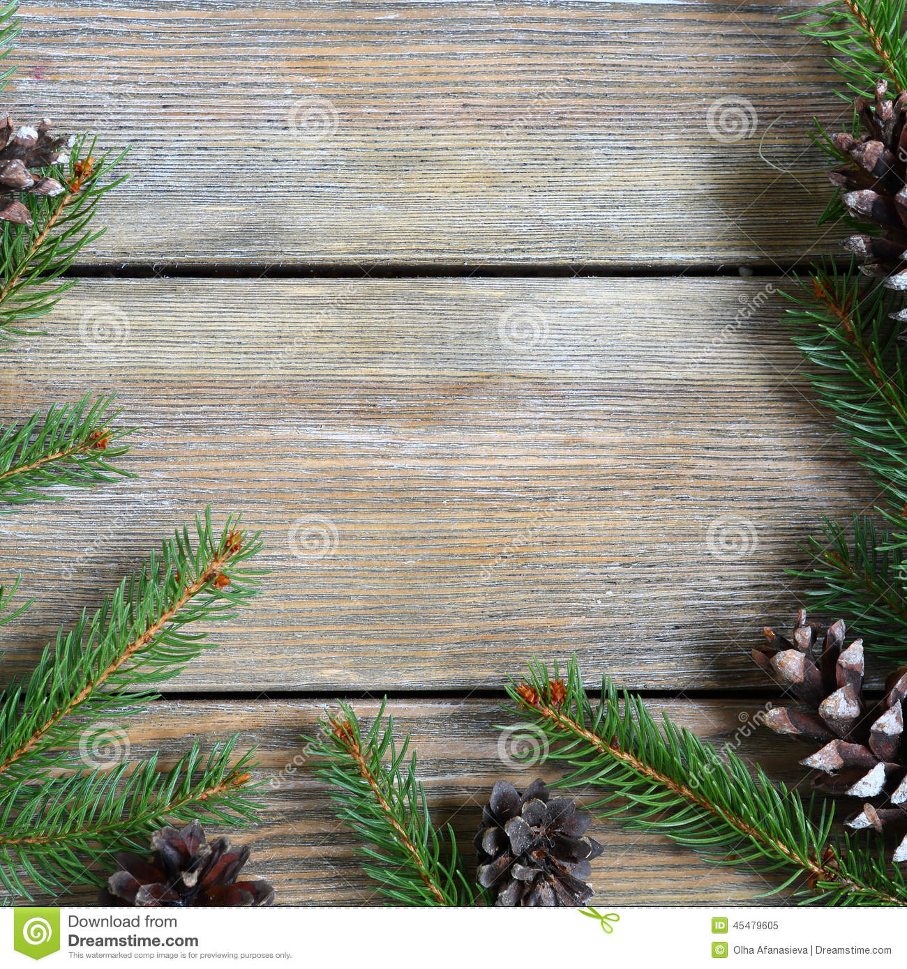 Xmas Frame With Pine Branch And Cones On Wooden Boards