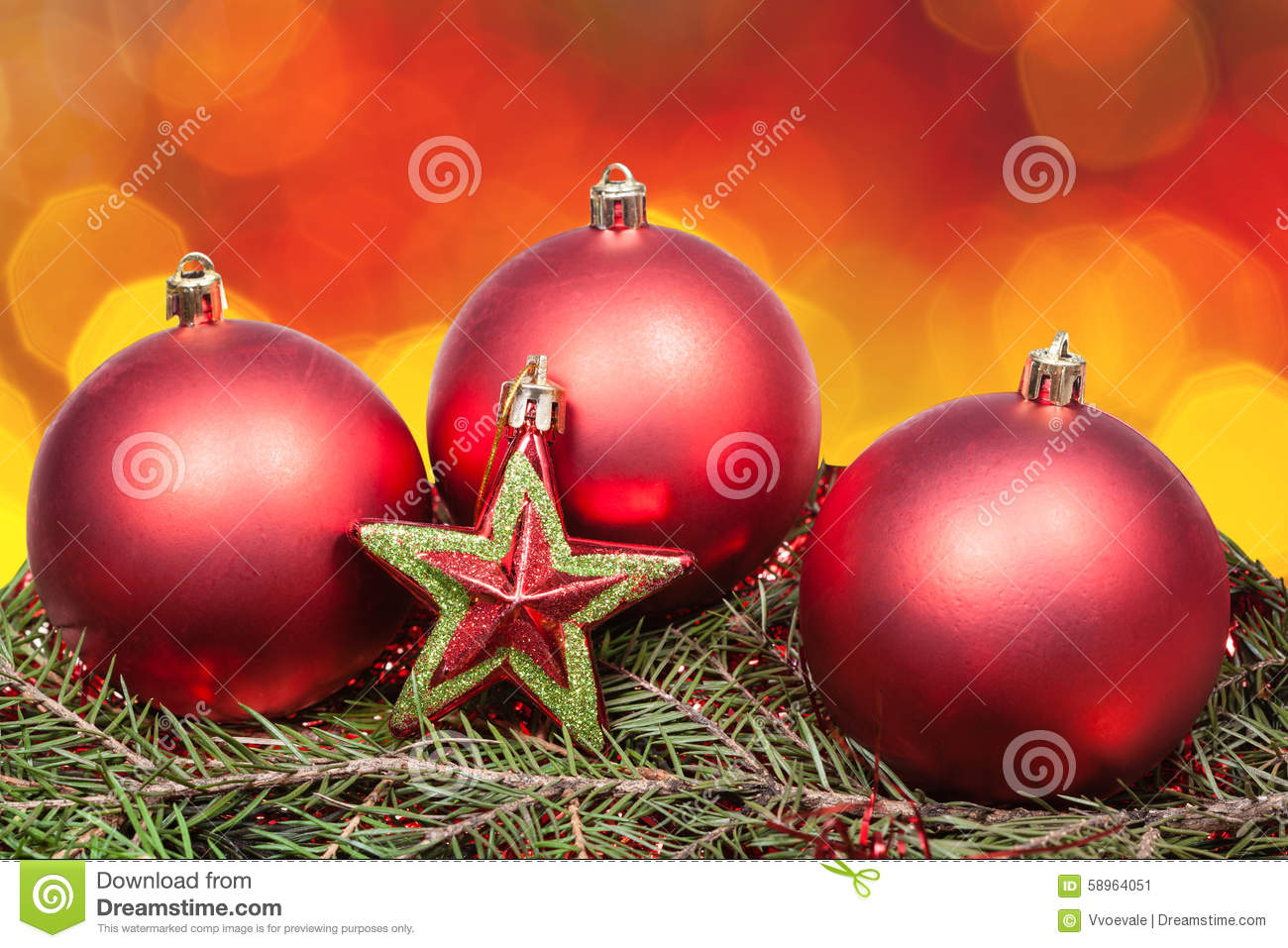 Xmas red bauble and star on blurred red background stock for Red and yellow christmas tree