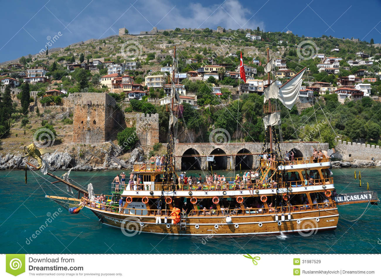 A yacht on the background of the fortress in Alanya