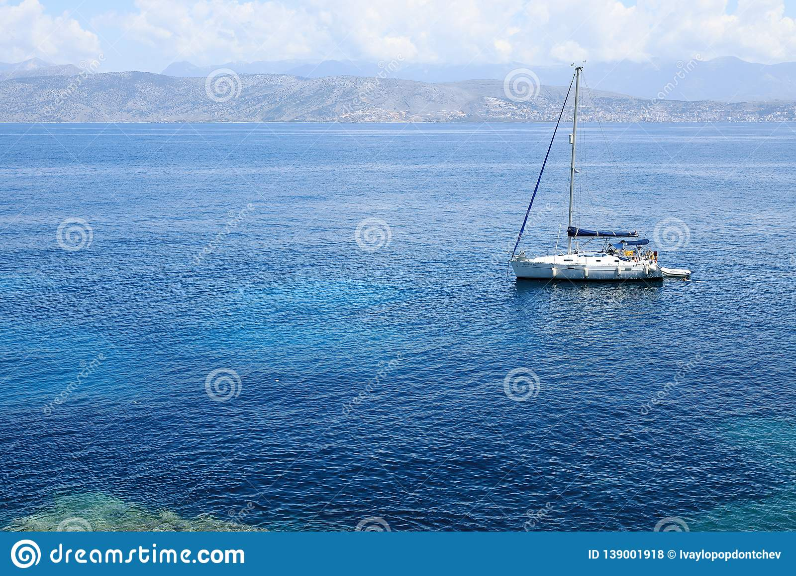 A yacht in Ionian Sea near Kanoni Beach, Kassiopi Village, Corfu Island, Greece, Europe