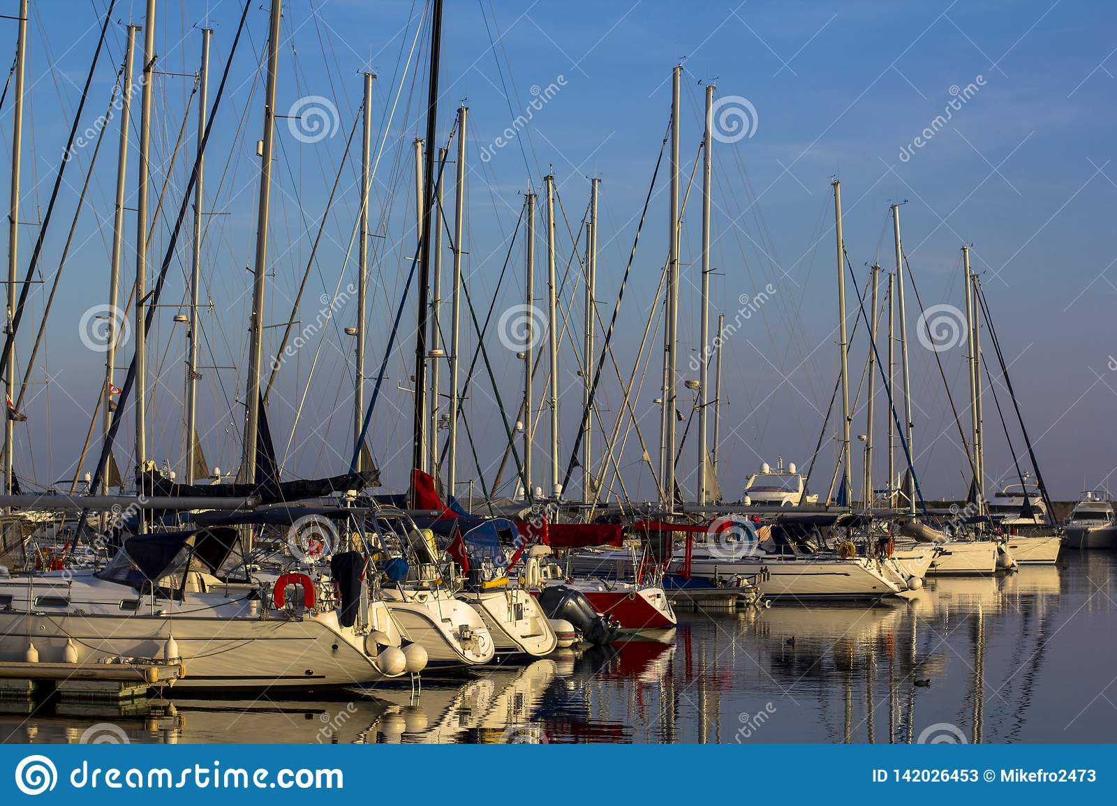 Yacht and sailboat harbor during sunset in Istanbul