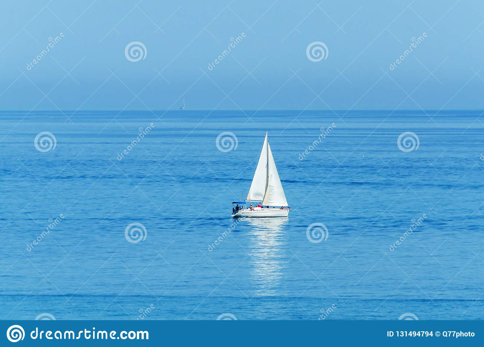 Yacht sailing the sea, clear sky and blue water, recreational sport, active rest