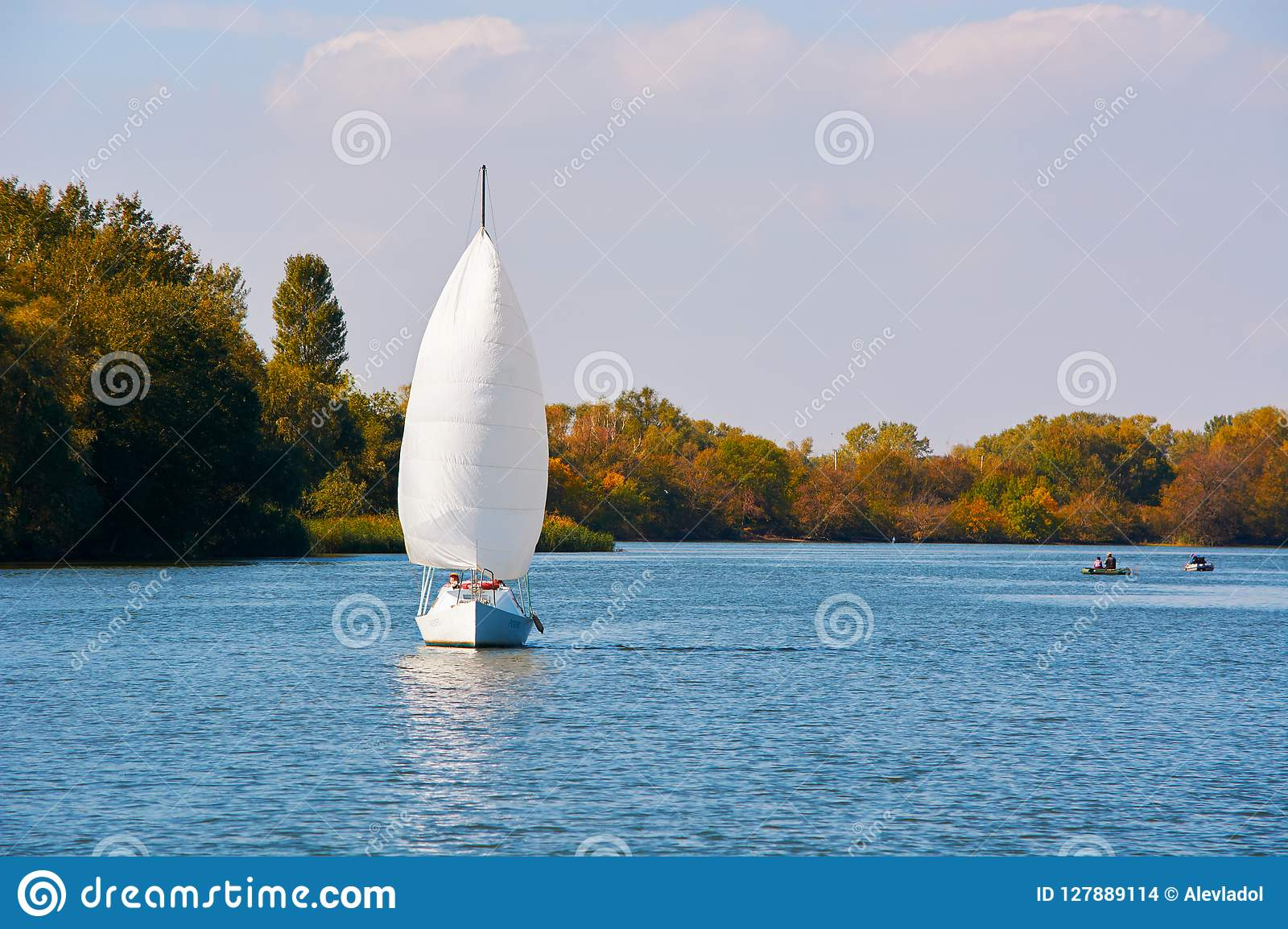 Yacht under the white sail