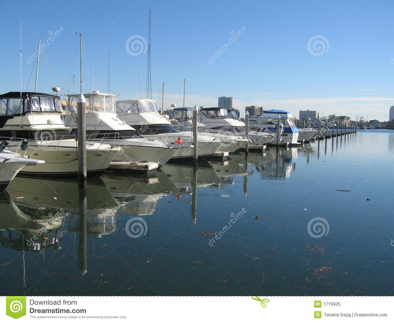 Yachts docked at a pier