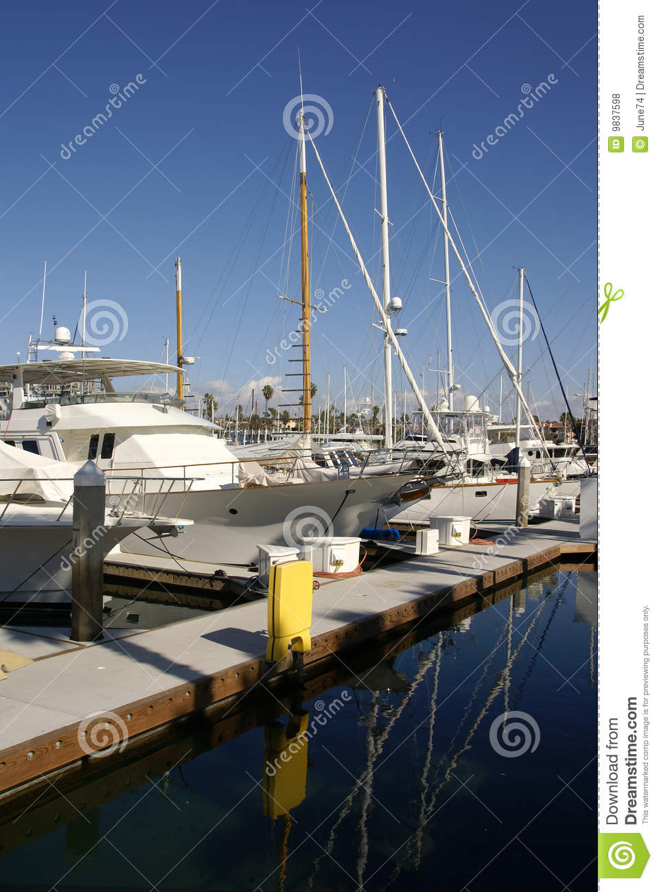 Sailing Yachts Parked In A Harbor Royalty-Free Stock Image | CartoonDealer.com #45128410