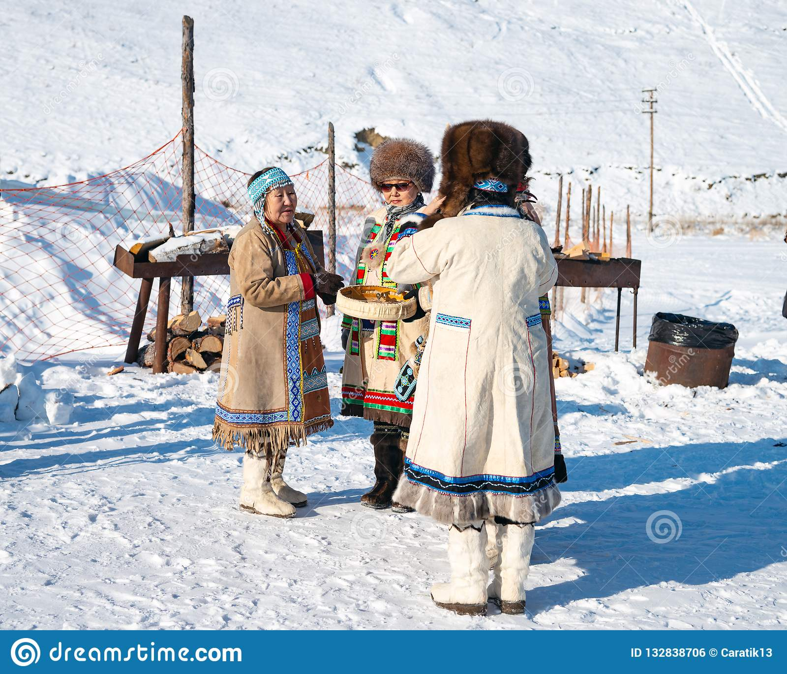 0f07a8a28b245 Yakutsk, Republic of Sakha Yakutia/Russia-March 01 2015: three women in traditional  clothes and fur hats