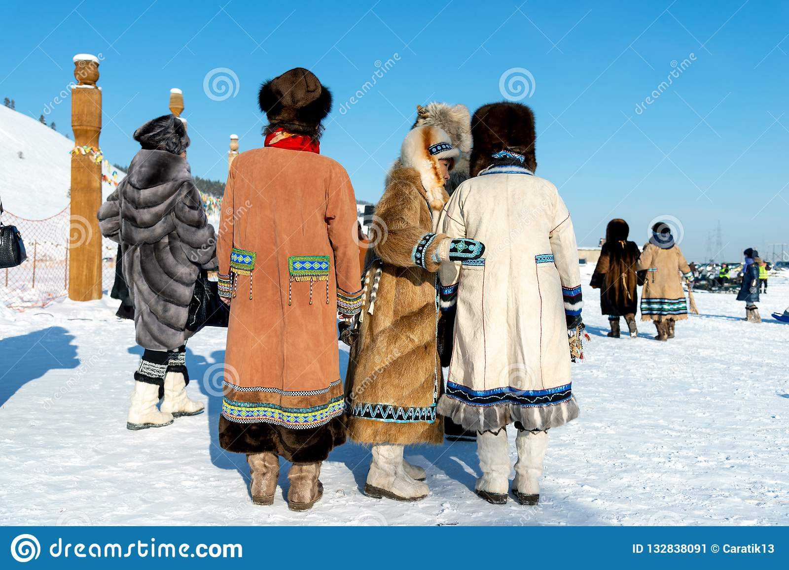 9d19caccc93f9 Yakutsk, Republic of Sakha Yakutia/Russia-March 01 2015: women in traditional  clothes and fur hats performing at the festival of the Meeting of the Sun