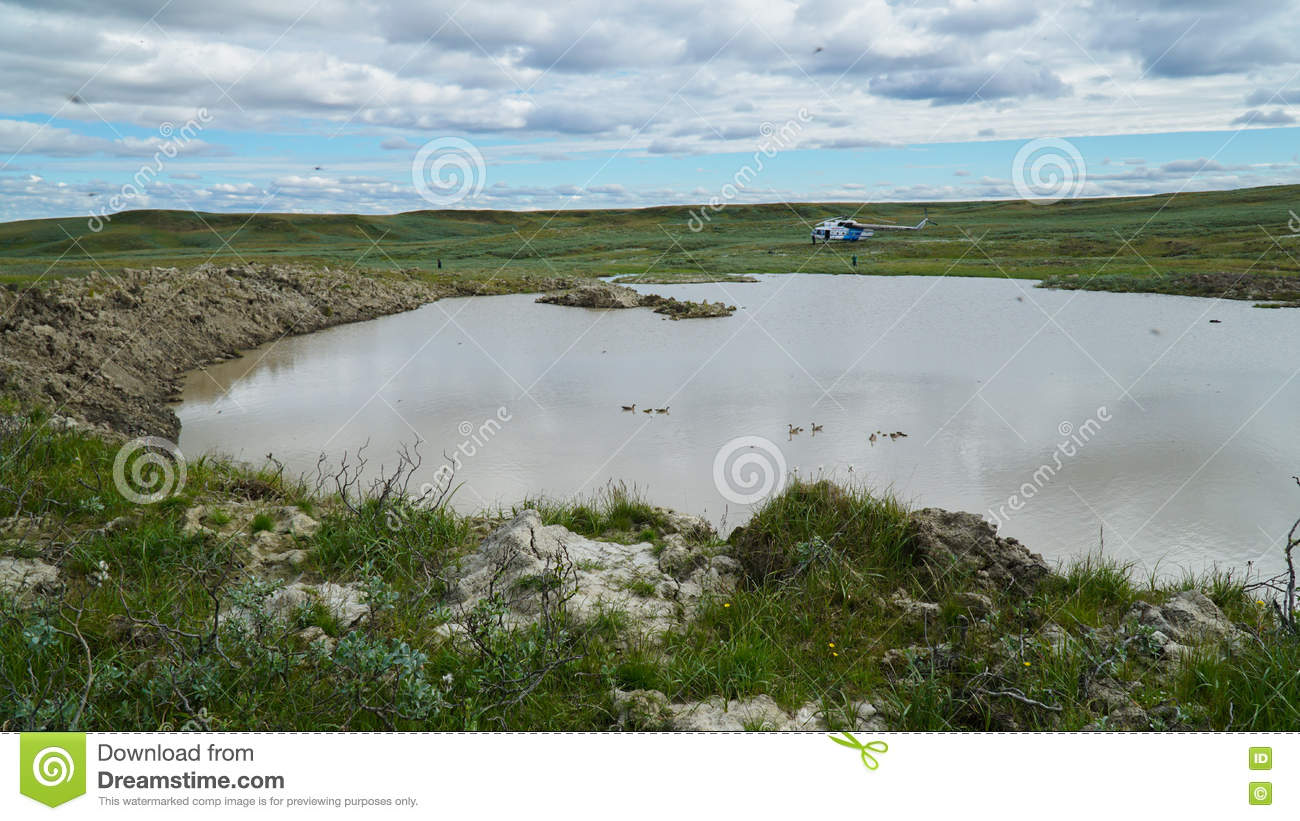YAMAL PENINSULA, RUSSIA - JUNE 18, 2015: Expedition to the giant funnel of unknown origin. Former crater, which became a