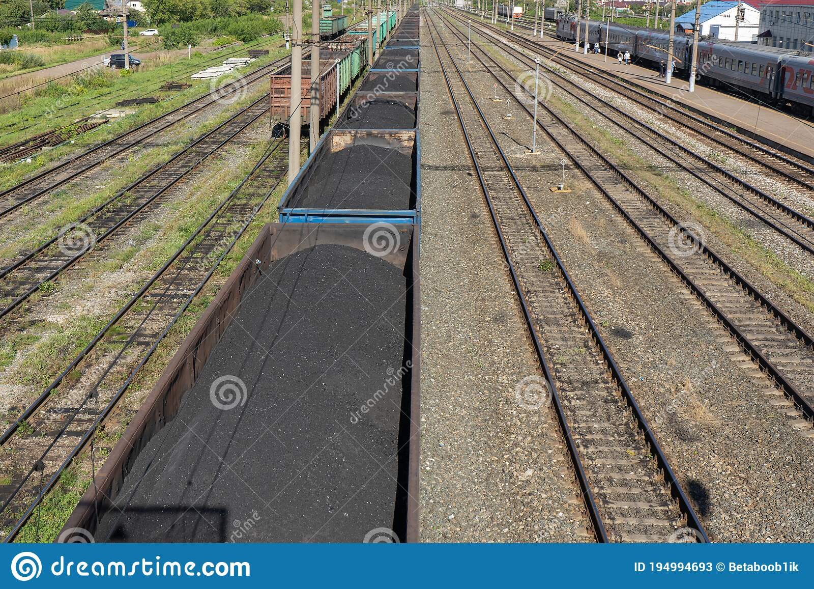 Workers above railway coach for maintenance works at