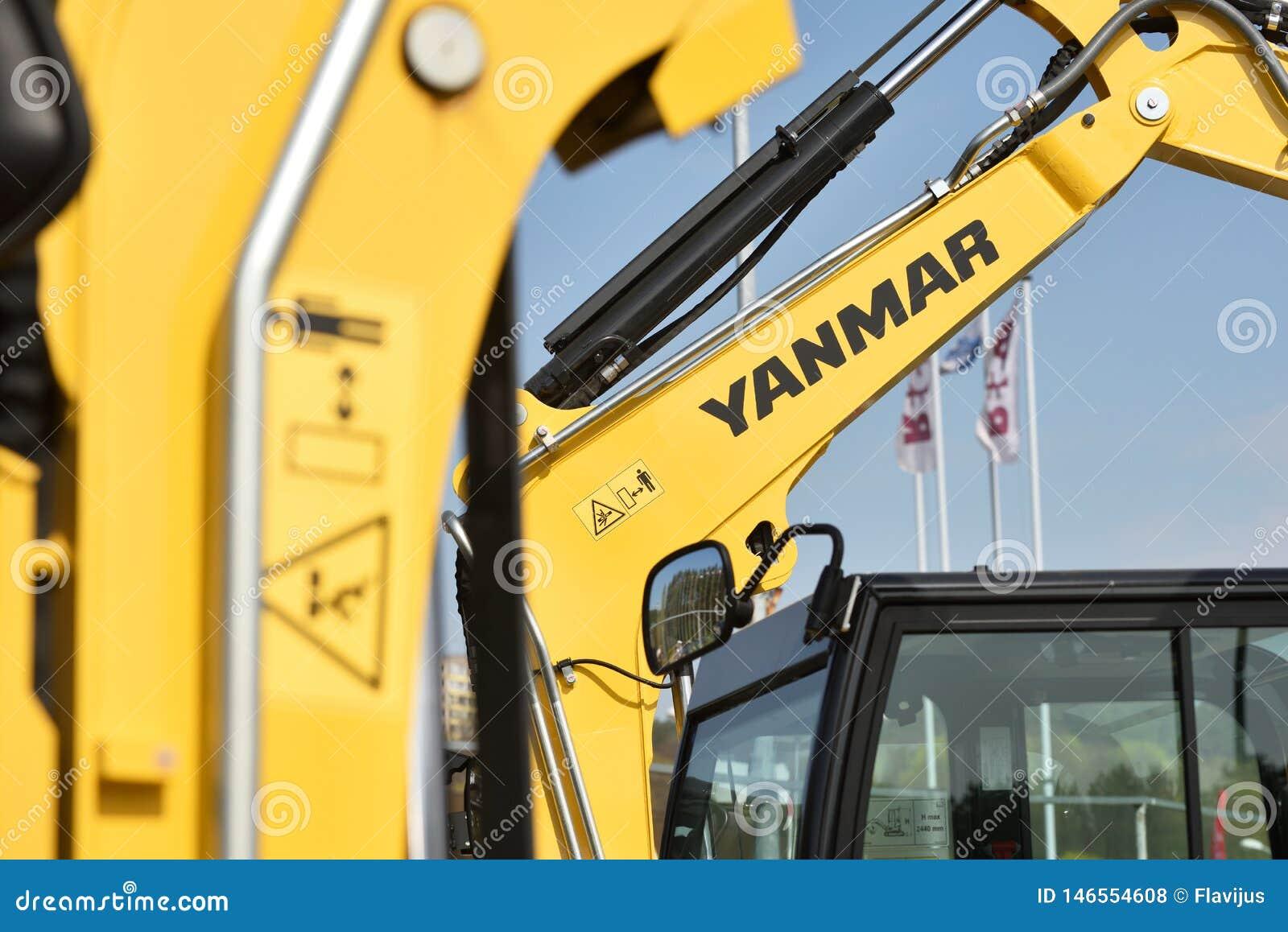 Yanmar excavator and logo editorial stock photo  Image of