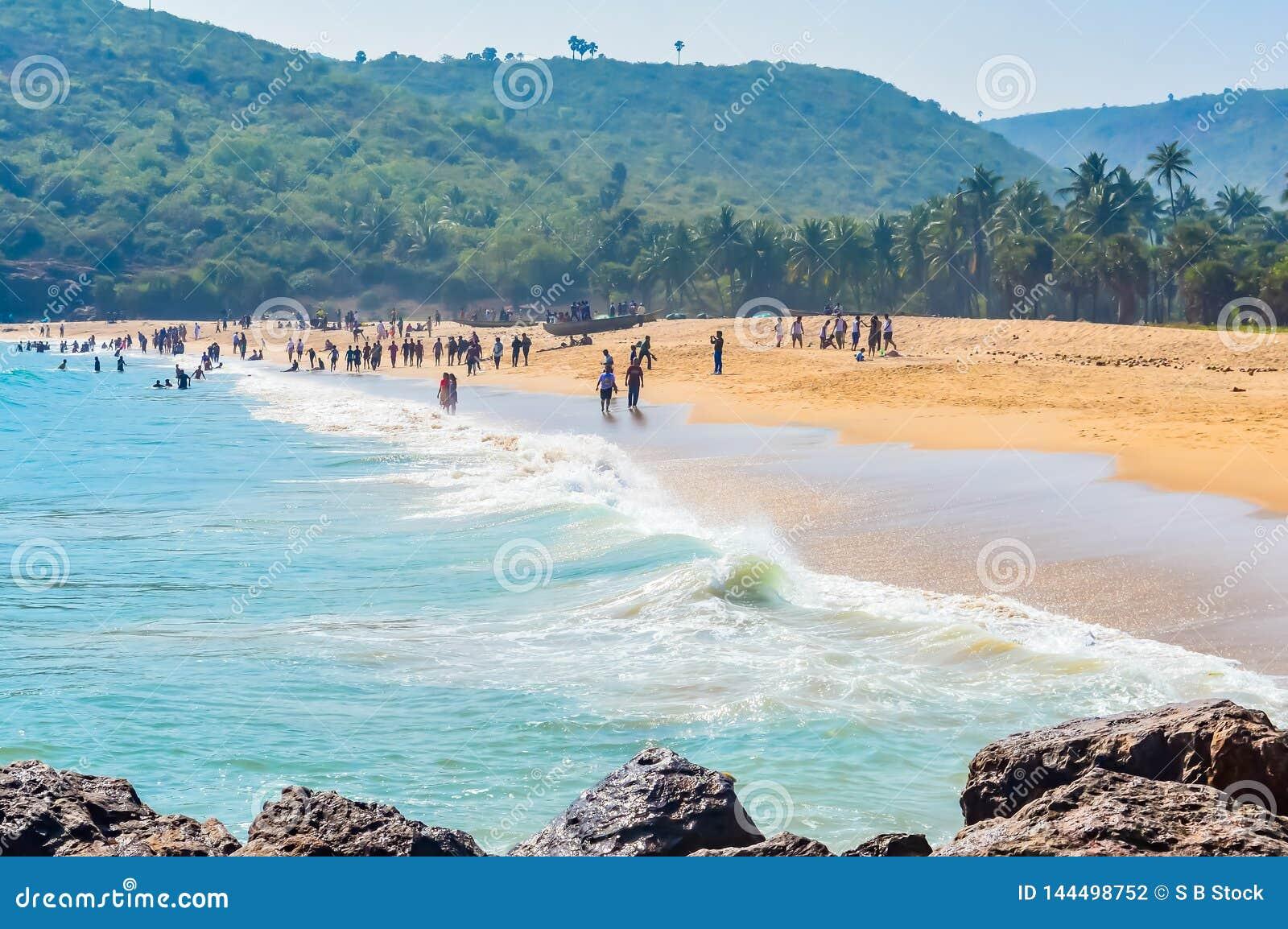 Yarada Beach, Visakhapatnam, India 10 December 2018 - People relaxing and enjoying in Yarada Beach. The Coast area is surrounded