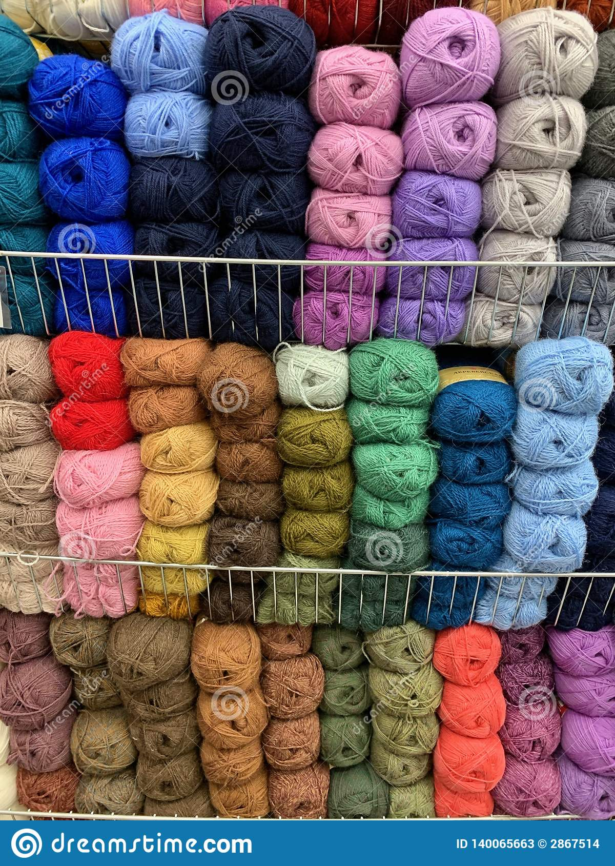 Multicolored, wool ball yarn in a store. ready for needlework.