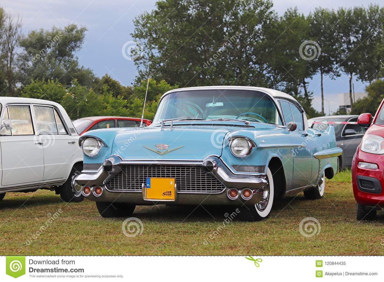 Yaslo, Poland - july 3 2018:a Old American classical cadillus of blue color. Front headlight with bumper and company logo. Collect