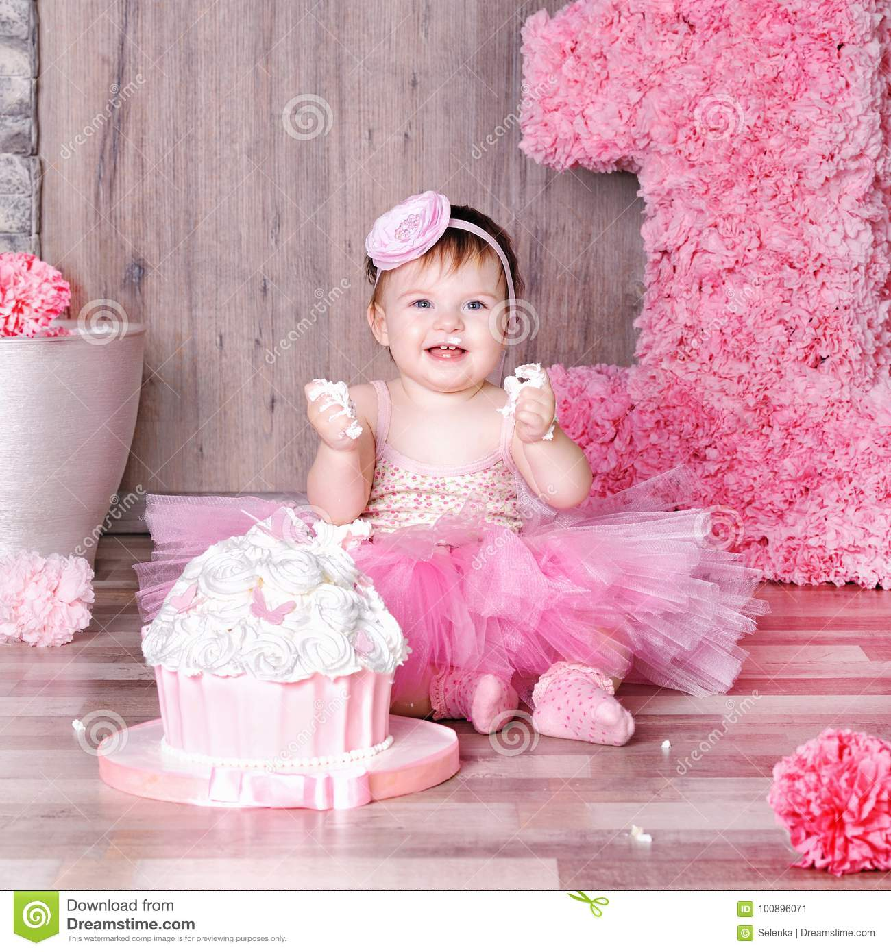 1 Year Baby Girl In Pink Dress With Her First Birthday